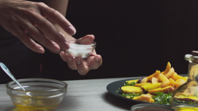 seasoning and salad table, vegetarian salad, crab add salt and pepper