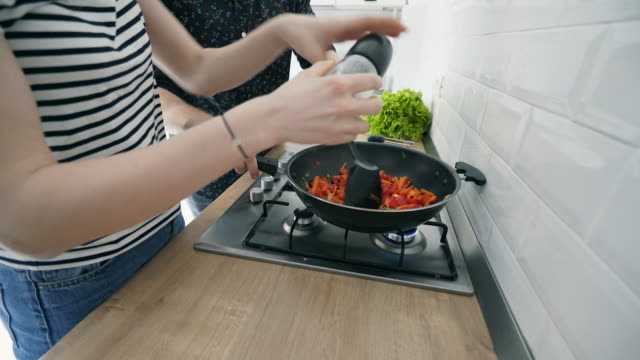 Seasoning food. video