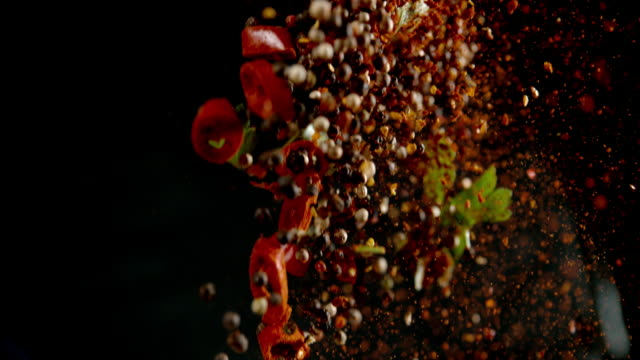 SLO MO Seasoning Super slow motion shot of spices falling on a black background. spice stock videos & royalty-free footage