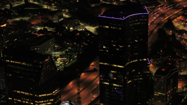 Seattle Aerial v107 Birdseye closeup shot flying low over downtown at night