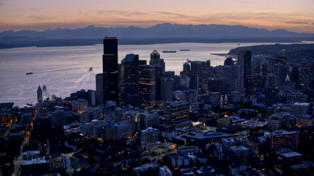 AERIAL Seattle and Elliott Bay at dusk Aerial shot of the Seattle and Elliott Bay at dusk. Shot in WA, USA. seattle stock videos & royalty-free footage