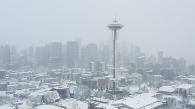 Seattle Blizzard Winter Snowy Day Downtown Skyline Aerial View of City Landscape - Cold Weather Snow Storm Frozen Buildings Seattle Blizzard Winter Snowy Day Downtown Skyline Aerial View of City Landscape - Cold Weather Snow Storm Frozen Buildings seattle stock videos & royalty-free footage