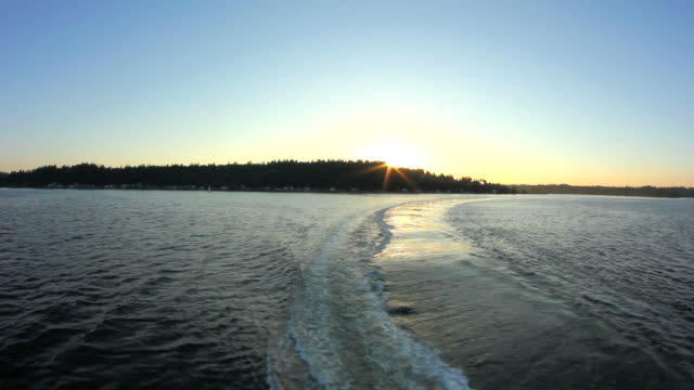 Seattle Ferry Ride Rear View Land Sunset video