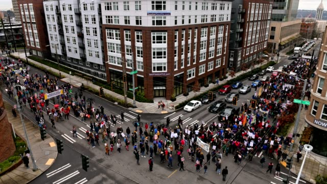 Seattle MLK Thousands fill the streets to march on Martin Luther King Jr. day in downtown Seattle. martin luther king jr day stock videos & royalty-free footage