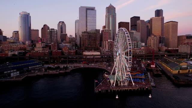 Seattle Skyline at Sunset, Ocean Flyover - Aerial Shot video