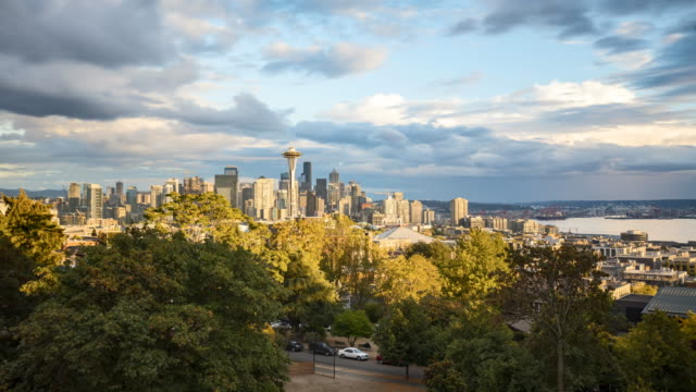 Seattle skyline time-lapse with moving clouds on a sunny day, Washington, USA Time-lapse video of Seattle skyline from famous Kerry Park panorama viewpoint on a beautiful sunny day with blue sky and fast moving clouds in summer, Washington State, Pacific Northwest, USA. seattle stock videos & royalty-free footage
