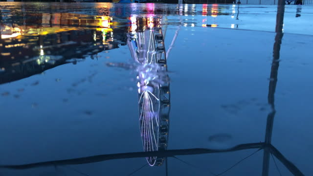 Seattle A reflection of the waterfront in a puddle while it rains. seattle stock videos & royalty-free footage