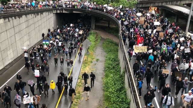 Seattle A time lapse of the  protest flooding onto Interstate 5 in downtown Seattle. seattle stock videos & royalty-free footage