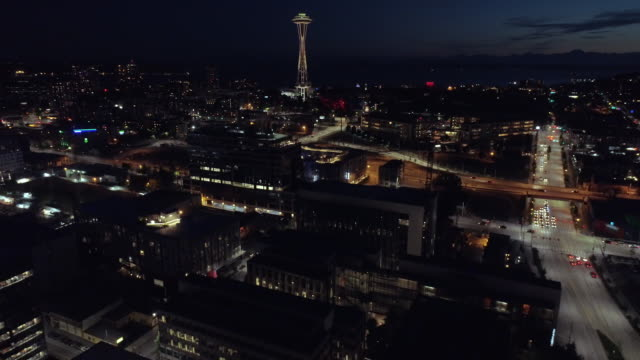 Seattle, WA Circa 2017: Aerial Panning Up to World Famous Space Needle at Night video