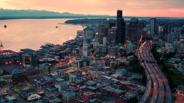 Seattle Washington Aerial Above Highway Lanes Traffic Skyline Waterfront Cityscape Orange Sky Sunset Lighting Dusk