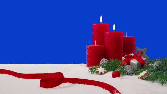 Second Sunday of Advent - Christmas decoration arrangement on a snowy table in front of a blue screen video