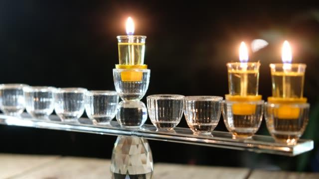 vídeos y material grabado en eventos de stock de segundo día de hanukkah. hanukkiah con quema dos y ocho o nueve velas e - hanukkah