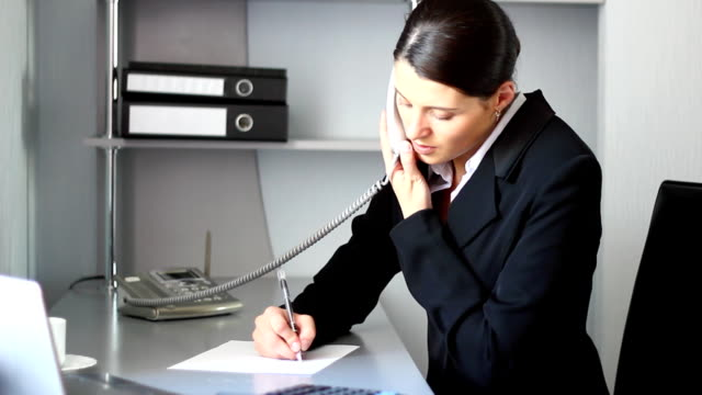 Secretary answers the telephone call. Beautiful secretary answers the telephone call. HD. telephone receiver stock videos & royalty-free footage