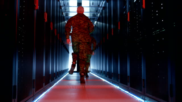 Security Alarm with Flasher Triggered in Data Center. Two Military Men Running in the Corridor full of Server Racks. video