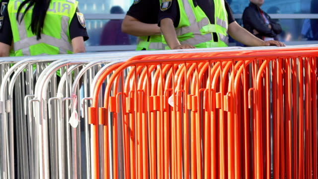 Security staff installing iron border to check tickets and control crowd of fans Security staff installing iron border to check tickets and control crowd of fans security staff stock videos & royalty-free footage