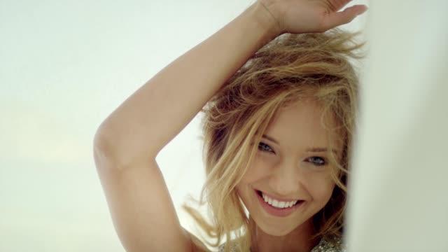 vídeos de stock e filmes b-roll de seductive woman hiding behind transparent curtain - cabelo comprido