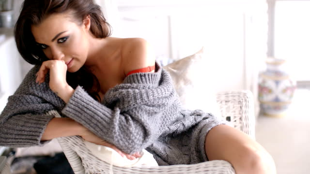 Seductive Woman in Cardigan Touching her Hair video