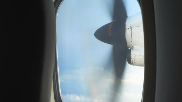 See through airplane window seat to see airplane blade when flying in sky