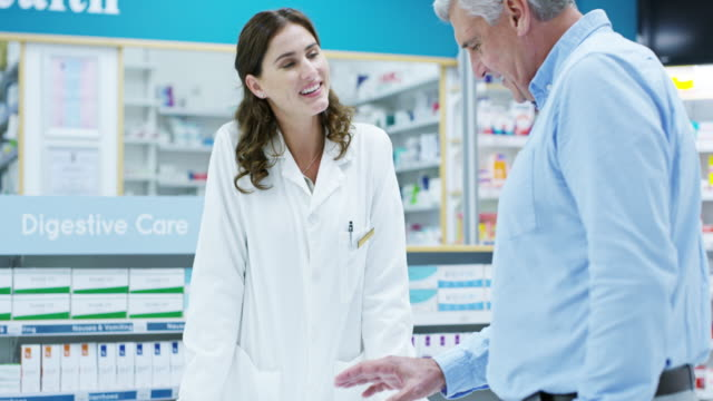 Seems that was the last one... 4k video footage of an attractive young female pharmacist helping a senior man in the pharmacy pharmacist stock videos & royalty-free footage