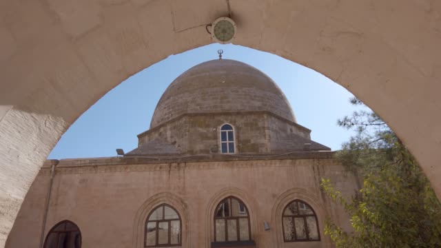 Sehidiye mosque and its dome, Mardin, Turkey Mardin, Turkey - January 2020: Sehidiye mosque and its dome mardin stock videos & royalty-free footage