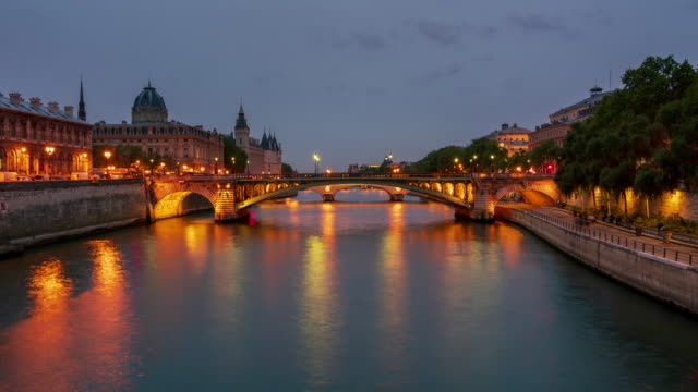 Seine river and the Conciergerie from Pont d'Arcole in Paris time lapse