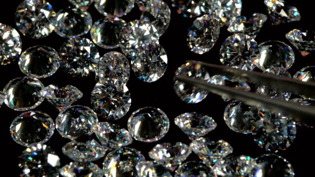 Selecting White Diamond With Pincers. video