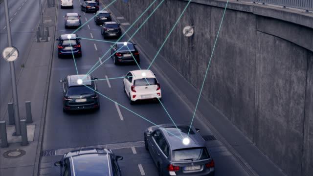 self driving autonomous cars on city street - infrastrutture video stock e b–roll