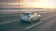 istock Self driving autonomous electric car driving along a bridge 1297230112