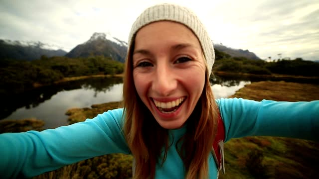 Self portrait of a young female hiking in New Zealand video