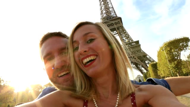 Self portrait of couple at the Eiffel tower video