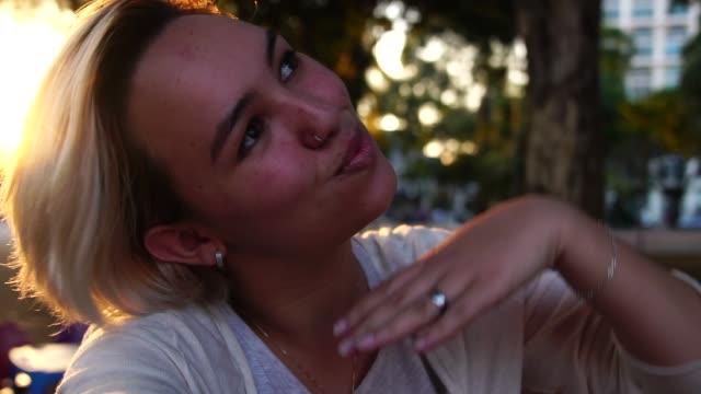 self portrait - selfie of young girl on sunset time - krótkie włosy filmów i materiałów b-roll