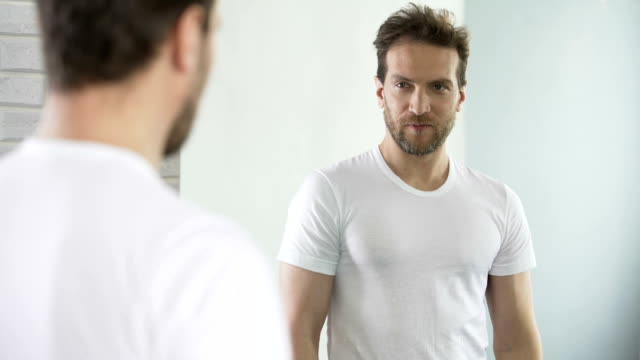 Self-centered man motivating and setting himself up for success during workday video