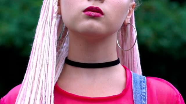Self-confident stylish teen female posing on camera, self-expression, beauty