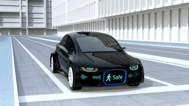 Self-driving car's front grille showing digital signage for pedestrian video