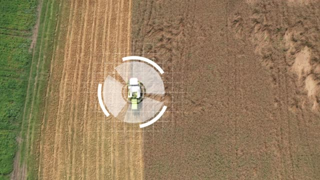 Self-driving harvesters ride on wheat field and harvest Satellite control of agricultural machinery intelligence stock videos & royalty-free footage