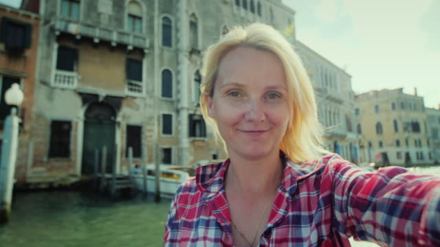 Selfi on the background of the Grand Canal in Venice. A young woman shoots herself on video. Tourism in Italy video