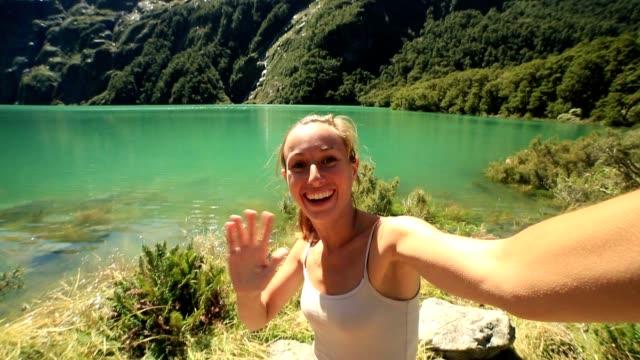 Selfie by mountain lake in New Zealand video