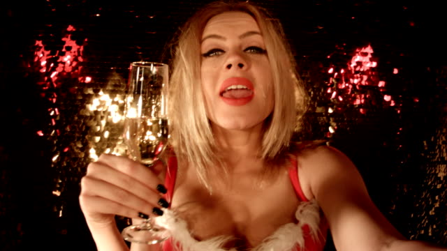 Selfie From a Nightclub. 'Merry Christmas' 'Happy New Year' Sensual Blonde Girl Taking a Selfie in Front of Glittering Background at Nightclub. video