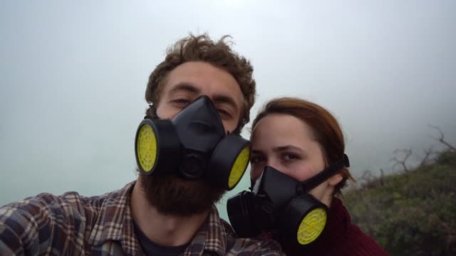 Selfie of couple in masks on Ijen sulfur minings