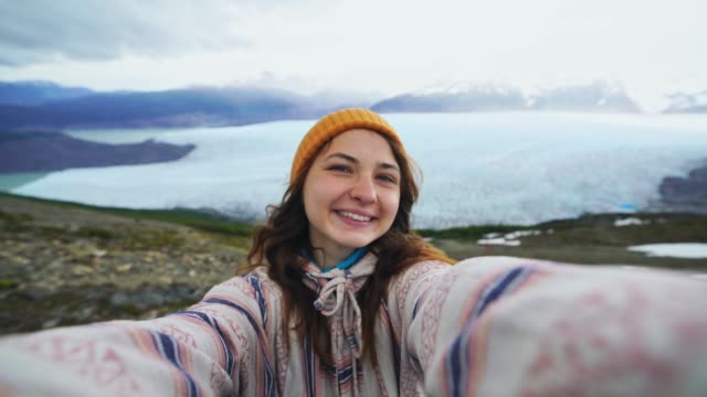 Selfie of woman on the background of  Grey glacier in Torres del Paine National Park