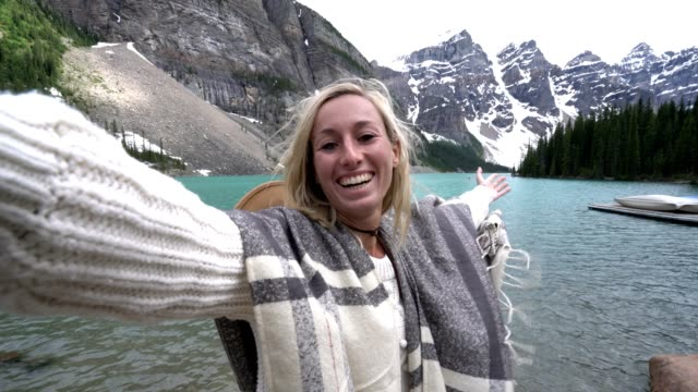 selfie of young woman by the lake - canada travel stock videos and b-roll footage