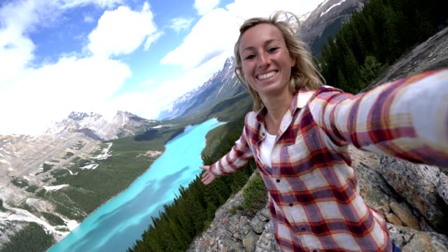 Selfie of young woman traveling in Banff national park, Canada video