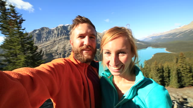 Selfie time in Peyto lake, hiking couple video
