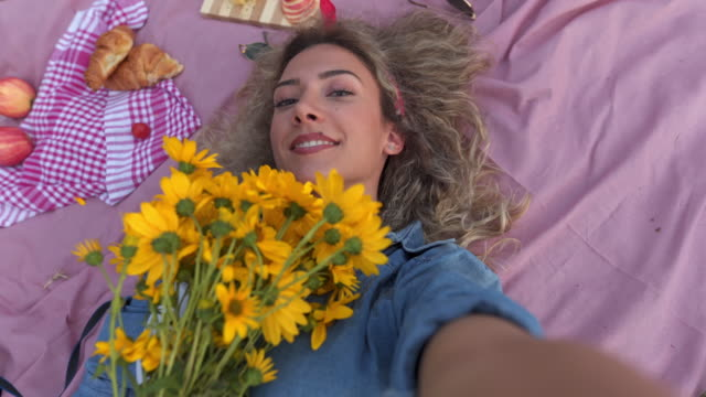 Selfie with some fresh yellow flowers
