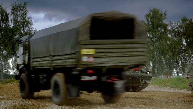self-propelled anti-aircraft vehicles on dirt road - caravan stock videos & royalty-free footage