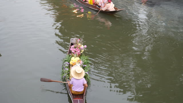Selling fruits and vegetables in floating market in Bangkok video