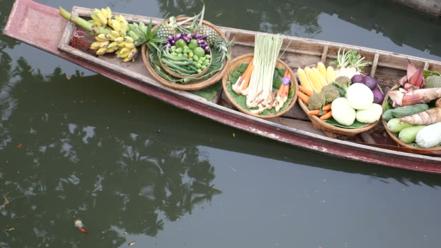 Selling fruits and vegetables in floating market video