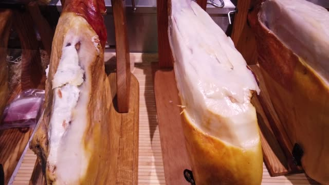 Selling jamon in a store. video