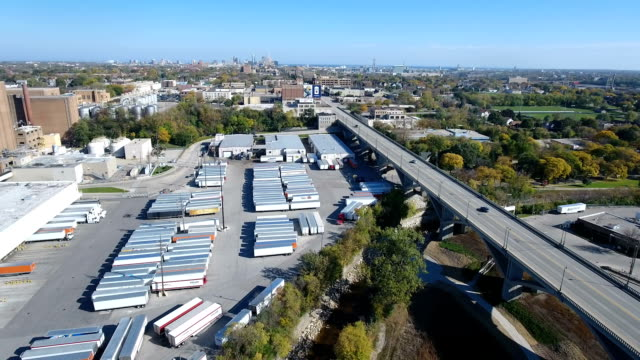 Semi trailers in an industrial yard video