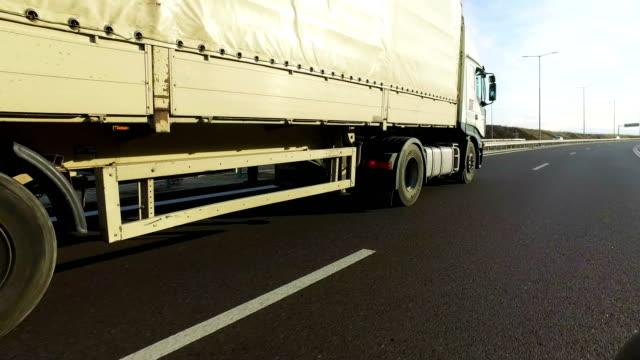 semi truck overtaking fast on highway, pov - bułgaria filmów i materiałów b-roll